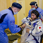 In the Integration Facility at the Baikonur Cosmodrome in Kazakhstan, Expedition 44 crewmember Kimiya Yui of the Japan Aerospace Exploration Agency suits up in his Sokol launch and entry suit July 11 as part of a fit check dress rehearsal. Yui, Kjell Lindgren of NASA and Oleg Kononenko of the Russian Federal Space Agency (Roscosmos) will launch July 23, Kazakh time from Baikonur in their Soyuz TMA-17M spacecraft for a five-month mission on the International Space Station. Credit: Gagarin Cosmonaut Training Center
