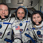 ISS043E174185 (05/06/2015) --- NASA astronaut Terry Virts (left) Commander of Expedition 43 on the International Space Station along with crewmates Russian cosmonaut Anton Shkaplerov (center) and ESA (European Space Agency) astronaut Samantha Cristoforetti on May 6, 2015 perform a checkout of their Russian Soyuz spacesuits in preparation for the journey back to Earth.