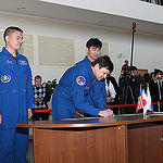 CG4G8895 --- (6 May 2015) --- At the Gagarin Cosmonaut Training Center in Star City, Russia, Expedition 44/45 Soyuz Commander Oleg Kononenko of the Russian Federal Space Agency (Roscosmos) signs in for the first of two days of qualification exams May 6 as