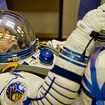 In the Integration Facility at the Baikonur Cosmodrome in Kazakhstan, Expedition 44 crew member Kimiya Yui of the Japan Aerospace Exploration Agency undergoes a pressure and leak check of his Sokol launch and entry suit July 11 as part of a fit check dress rehearsal. Yui, Kjell Lindgren of NASA and Oleg Kononenko of the Russian Federal Space Agency (Roscosmos) will launch July 23, Kazakh time from Baikonur in their Soyuz TMA-17M spacecraft for a five-month mission on the International Space Station. Credit: Gagarin Cosmonaut Training Center