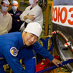 In the Integration Facility at the Baikonur Cosmodrome in Kazakhstan, Expedition 44 crewmember Kimiya Yui of the Japan Aerospace Exploration Agency poses for pictures July 11 prior to entering his Soyuz TMA-17M spacecraft during a fit check dress rehearsal session. Yui, Kjell Lindgren of NASA and Oleg Kononenko of the Russian Federal Space Agency (Roscosmos) will launch July 23, Kazakh time from Baikonur in their Soyuz TMA-17M spacecraft for a five-month mission on the International Space Station. Credit: Gagarin Cosmonaut Training Center
