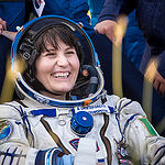 Expedition 43 Italian astronaut Samantha Cristoforetti from European Space Agency (ESA) rests in a chair outside the Soyuz TMA-15M spacecraft just minutes after she and NASA astronaut Terry Virts of NASA, and cosmonaut Anton Shkaplerov of the Russian Fede